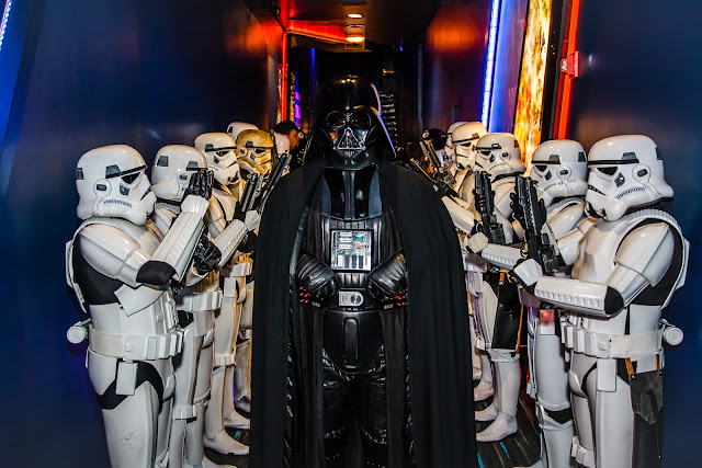 Darth Vader with troopers at attention
