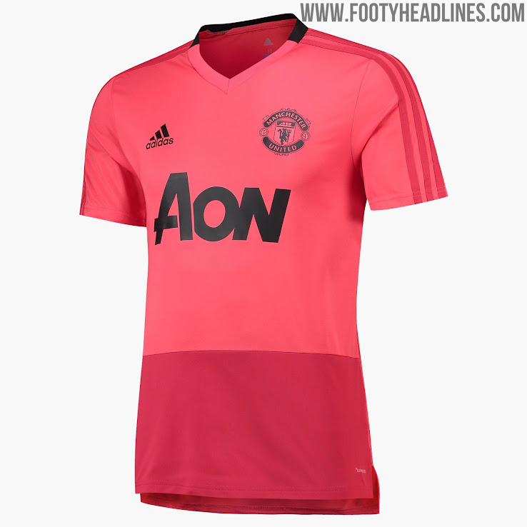 +1. All logos on the front of the pink Manchester United training shirt are  also ... 51b562349