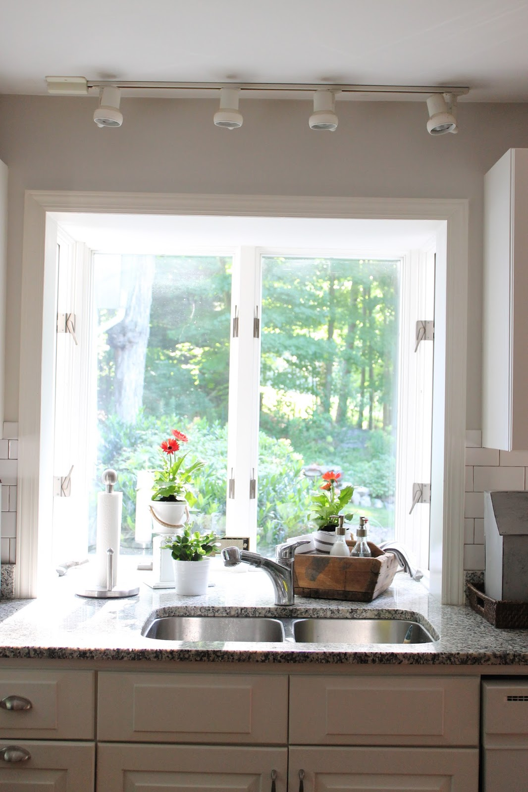 Over The Kitchen Sink Lighting Cabinet Displays For Sale Picket Fence Projects Pretty Pb Pendants
