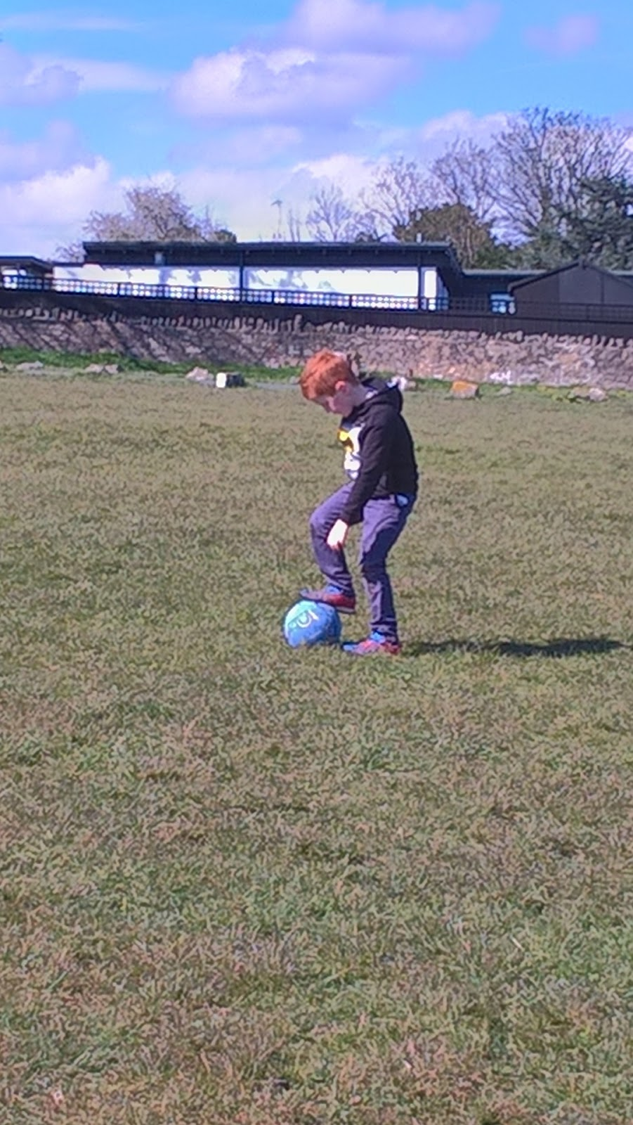 Ieuan Hobbis playing football on Dinas Powis Common