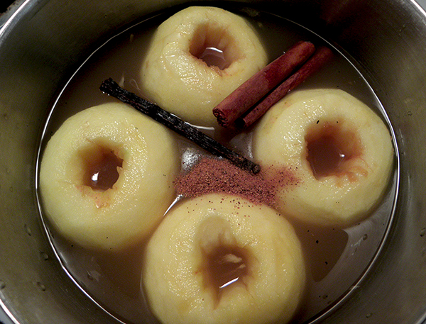 Four Apples in Pot with Juice and Spices