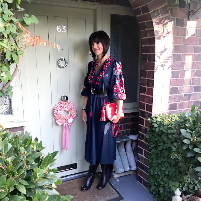 My Midlife fashion, lotus shoes yukka black leather knee high boots, and other stories waist belt, zara embroidered boho midi dress, uterus mock croc leather cross body bag