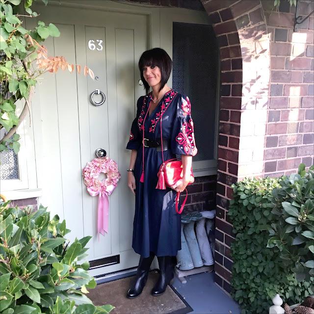 My Midlife fashion, lotus shoes yukka black leather knee high boots, and other stories waist belt, zara embroidered boho midi dress, uterus mock croc leather cross body bag