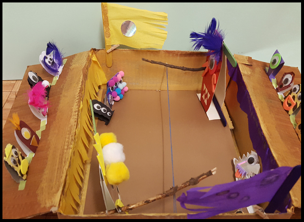 Creating a paper monster battlefield with the kids
