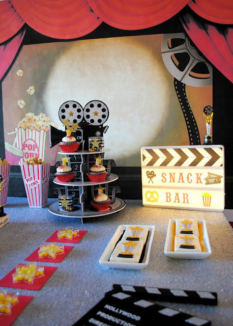 Throw a snack bar movie themed Oscar party. Inspiration found at www.fizzyparty.com
