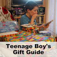 Boy looking thrilled with a pile of birthday gifts