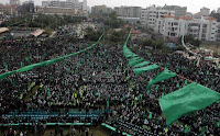 Thousands of supporters of the Islamist movement Hamas gather in Gaza City to celebrate the 24th anniversary of its foundation on December 14, 2011.