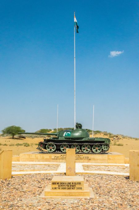 Indian Flag flying high with a a captured Pakistani tank kept beneath it.