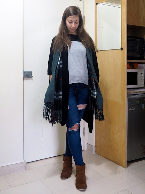 Rough Around the Edges | casual outfit of grey t-shirt, black cape cardigan, cosy checked scarf, ripped jeans and brown ankle boots