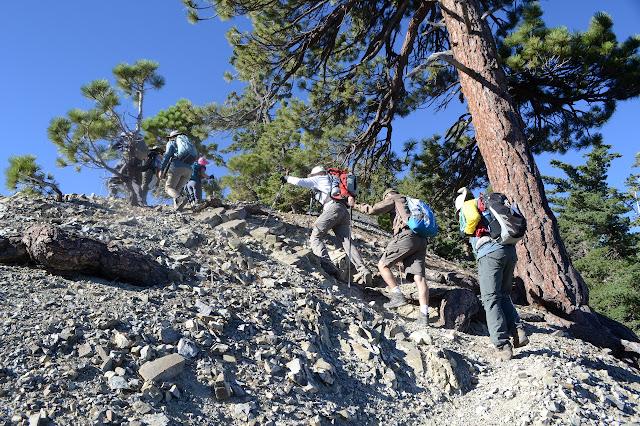 hikers on the steep