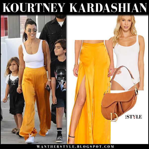 Kourtney Kardashian in white bodysuit, orange pants and brown bag dior saddle august 26 2017