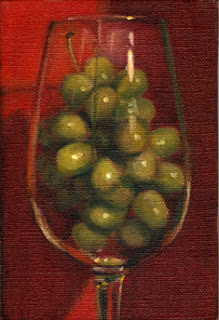 Oil painting of green plastic grapes in a wine glass with red background.