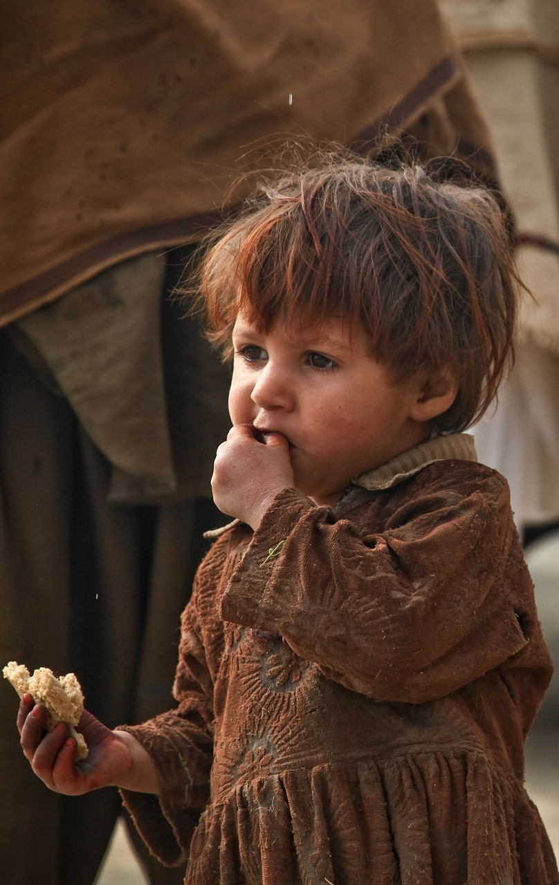 A child with piece of bread.
