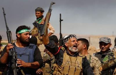 Milisi Syiah Bakari Masjid dan Rumah Sunni