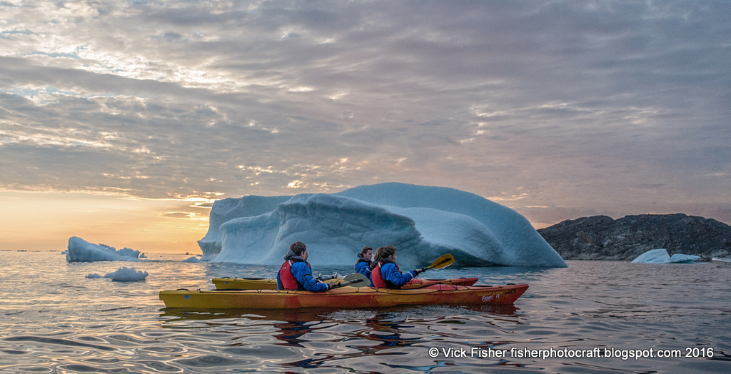 Greenland kayaking adventure travel sunset photography Ilulissat icebergs Disko Bay water cold ice group paddle Denmark nature wilderness beautiful beauty pristine clean white tourism tourist traveler vacation destination