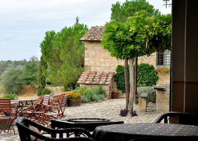 View of the Terrace at Borgo Argenina from the Breakfast Room - Gaiole in Chianti, Italy | Taste As You Go