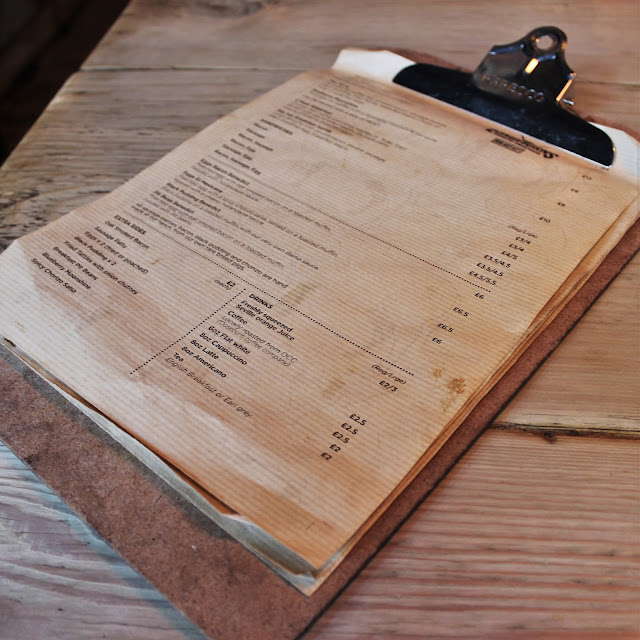 Longhorns BBQ Menu on a clipboard