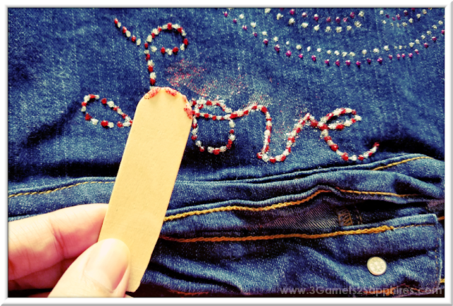 Adding painted abstract background effect on denim with Glitter Fabric Paint  |  3 Garnets & 2 Sapphires