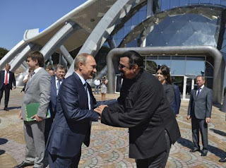 Putin gives Russian citizenship to action film actor Seagal