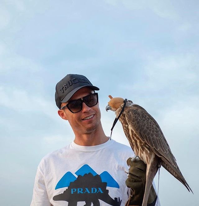 Cristiano Ronaldo pictured with a bird has he continues to enjoy holiday