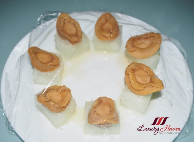 steamed baby abalones on winter melon cubes