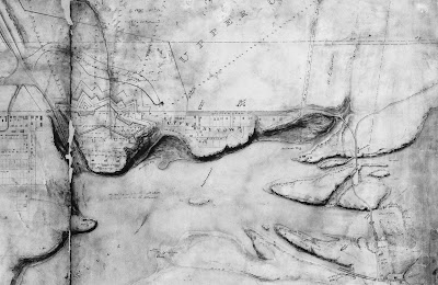Map drawing showing the Ottawa river in the foreground, the Rideau Canal locks to the left, Upper By Town in centre, and Chaudiere islands to the right. Between Wellington Street and the Rideau Canal is the outline of a fortress wall with jagged, but symmetrical, lines, extending south of Wellington Street, to protect the buildings on Barrrack Hill. Wellington Street is straight and wide between Kent and Concession line (later Bronson), after which a thin ribbon road extends west and turns north to cross the Ottawa River at the Chaudiere crossing. Formal lots are laid out between Wellington Street and the Ottawa River, with some buildings on it; this is labelled Upper By Town.