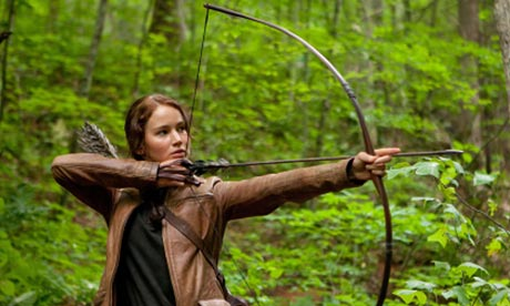 Katniss with bow and arrow The Hunger Games 2012 movieloversreviews.filminspector.com
