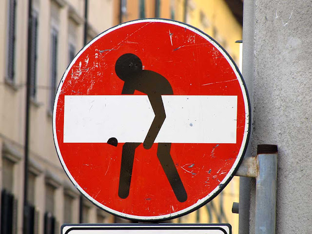 No entry sign with a guy carrying a huge beam, Clet Abraham, Livorno