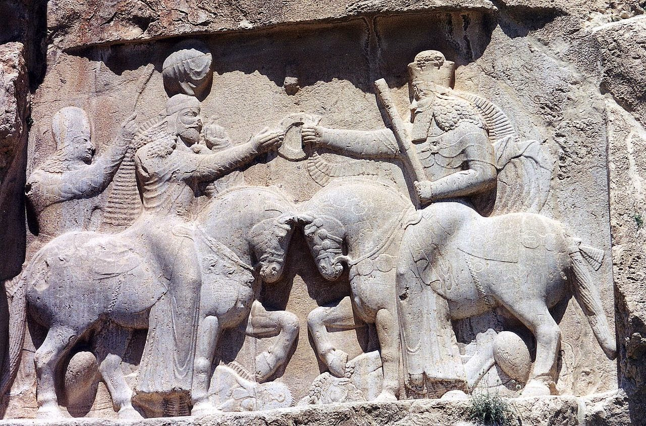 Ahura Mazda (right) presents Ardashir I (left) with the ring of kingship.