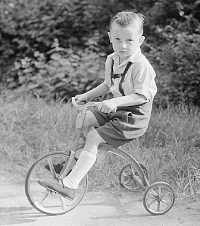 Boy on tricycle joke picture