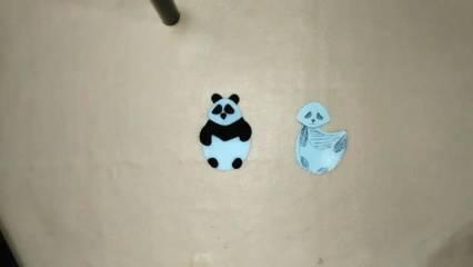 pola boneka panda