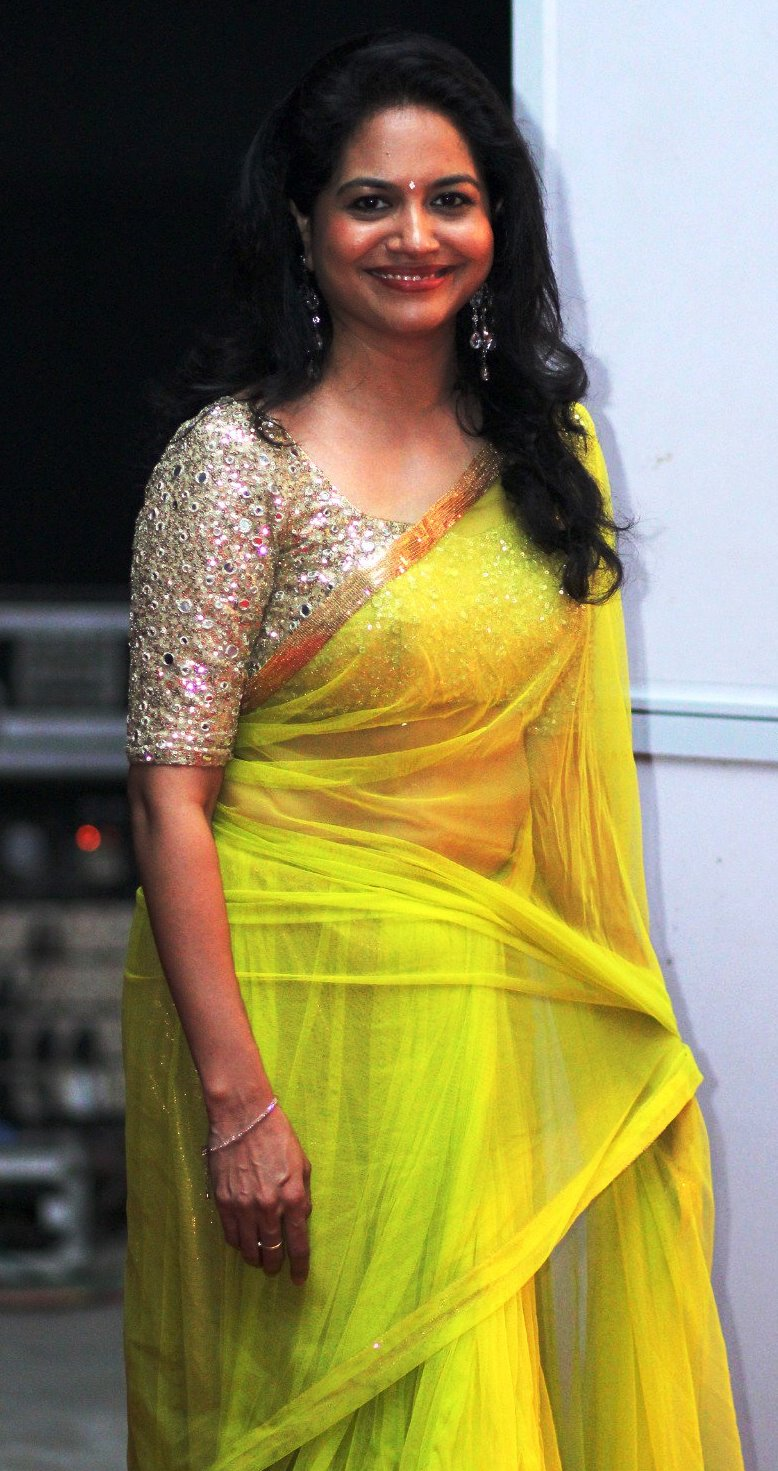 Singer Sunitha Long Hair Stills In Transparent Yellow Saree