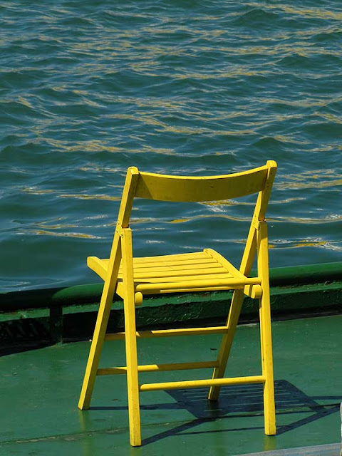 Yellow chair on a boat, Porto Mediceo, Livorno