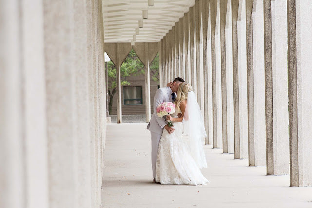 Bride and groom kissing at Wayne State