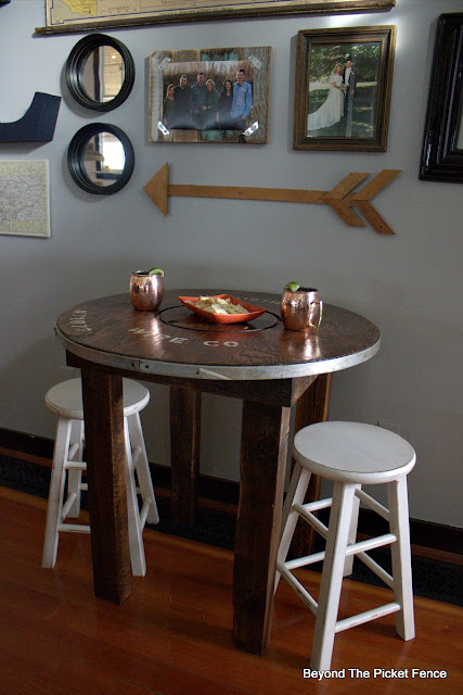create a cozy spot with a rustic industrial spool table