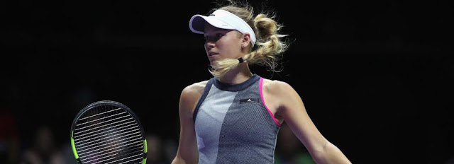 Wozniacki beats Venus Williams to clinch WTA finals trophy