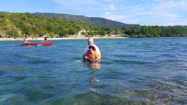 Father and son enjoying the water at Pacman Beach Resort Complex