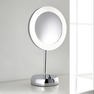 Silver coloured, round mirror on stand, with lights and magnification