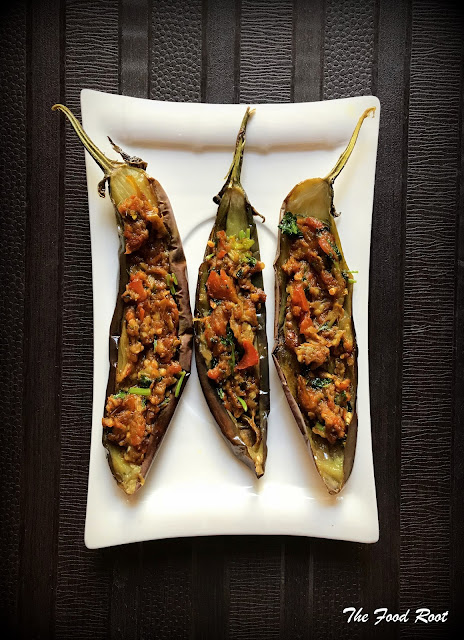 These beautiful Japanese aubergine are baked at 350 degress F for 15 minutes and filled with delicious stuffing of ginger, garlic, sauteed tomatoes, aubergine and a host of spices!