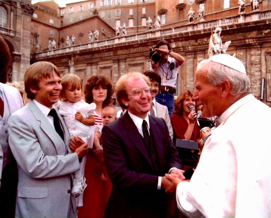 Living Sound's audience with Pope John Paul II at St. Peter's Basilica, Vatican City on August 13, 1980. (L to R) Joel Vesanen, Baby Anja Vesanen, Nancy McKibben, Carrie McKibben (4 mo.), Terry Law, Michael McKibben, US TV videographer, Pam Faye (Team III singer), Pope John Paul II