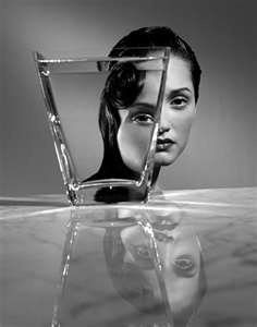 Woman through glass of water