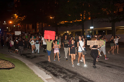 Black Lives matter protesters march down College Street in Greenville, SC in an attempt to block interstate 385 on July 9, 2016.