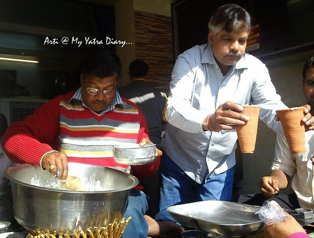 Whipping fresh curd at Lassiwala, MI Road, Jaipur