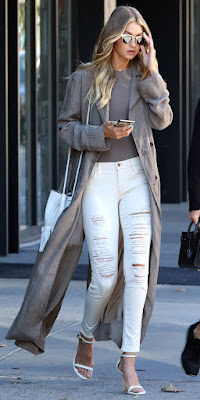 GIGI HADID Break up taupe layers (or any color, for that matter) with white destroyed jeans, a white bucket bag, and white heels.