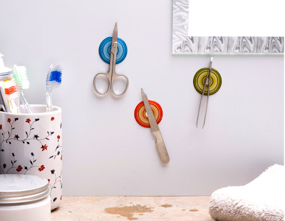 magnetic wall stickers holding small scissors, nail file and tweezers