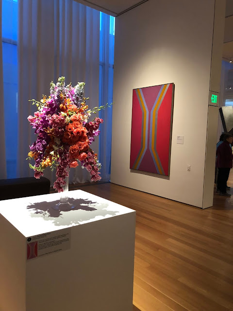 Designers create floral displays to work with pieces of art in the NCMA in Raleigh