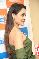 Pragya Jaiswal in a single Sleeves Off Shoulder Green Top Black Leggings promoting JJN Movie at Radio City 10.08.2017 132.JPG
