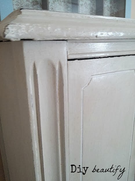 distressing and the addition of dark wax adds depth to an antique hutch