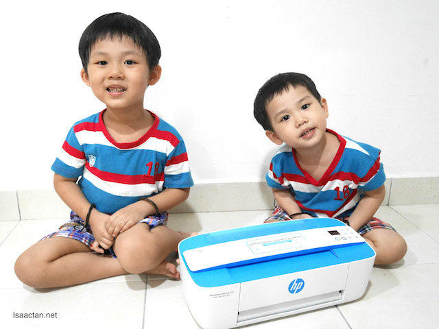 The kids with their new printer, all smiles!