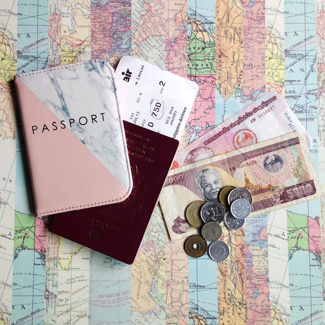 British Passport and foreign money flatlay